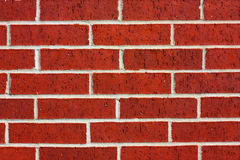 Red brick wall. Rough textured red brick wall with mortar Royalty Free Stock Image