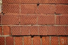 Red brick wall. Background of rough dirty red brick wall texture Royalty Free Stock Photography