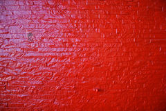 Red brick wall. Painted red brick shiny wall Royalty Free Stock Photos
