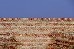 Red Brick Wall Against Blue Sky Royalty Free Stock Image