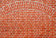 Red brick wall with arch. Red brick wall with an included arch royalty free stock photos
