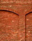 Red brick wall with arch Royalty Free Stock Images