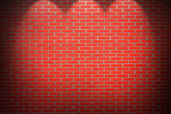 Red brick wall background with beams of light Stock Images
