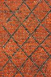 Red brick wall background with black diagonal lines.  royalty free stock photography