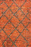 Red brick wall background with black diagonal lines.  royalty free stock photo