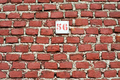 Red brick wall background with number 56 Stock Photo
