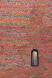 Red brick wall background with small window Stock Images