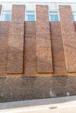 Red brick wall background on a street in England Stock Image