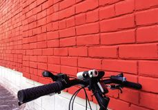 Red brick wall background, texture, the colors of the Polish flag,bike against the wall stock images