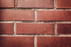 Red brick wall background. Texture of a stone wall. Close-up of bricks Royalty Free Stock Images
