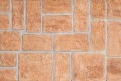 Red brick wall background. Wall decorative false bricks texture. Royalty Free Stock Photo