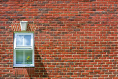 Red Brick wall background and window Royalty Free Stock Photo