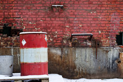 Red brick wall with barrel Stock Photo