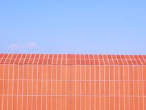 Red brick wall blue sky Royalty Free Stock Image