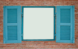 Red brick wall with blue wood window Stock Photo