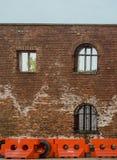 Red brick wall and bollards Stock Image