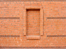 Red brick wall and brick up window. Abstract Stock Image