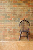 Red brick wall and chair on the wall Royalty Free Stock Photography