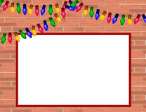 Red  brick wall with Christmas lights and frame for some text. Decorated red  brick wall with Christmas lights and place for text Royalty Free Stock Images