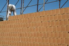 Red brick wall construction on construction site Royalty Free Stock Photography