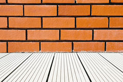 Red brick wall and deck background Stock Photo