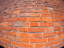 Red brick wall with distortion lens. And wide angle fisheye view stock photography