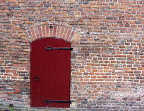 Red Brick Wall with a Door Stock Photography