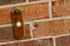 Red brick wall with doorbell. Mortared red brick wall with doorbell texture background Royalty Free Stock Photo
