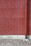 Red brick wall with drainpipe Stock Photo