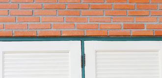 Red brick wall on the edge of the window. Red brick wall on the edge of window Stock Photo