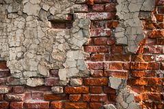 Brick wall with peeling plaster. Red brick wall with flaking plaster Royalty Free Stock Photos
