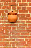 Red brick wall with flower pot. Traditional red brick wall with a empty flower pot Stock Photo