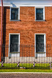 Red brick wall with four windows Royalty Free Stock Photos