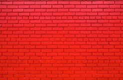 Red brick wall further back. Large brick wall that has been painted lipstick red Royalty Free Stock Photo