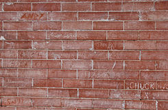 Red Brick Wall with Graffiti Scratch Stock Photography
