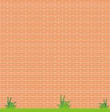 Red brick wall and grass Royalty Free Stock Photography