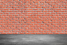 Red brick wall and gray asphalt floor. Empty abstract interior background with red brick wall and gray asphalt floor Stock Photo