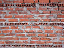 Red brick wall with grey mold. Three horizontal lines of black r Royalty Free Stock Photo