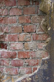 Red brick wall half covered with cement copy space Royalty Free Stock Photography