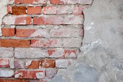 Red brick wall half covered with gray cement a lot of copyspace Stock Photography