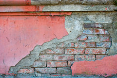 Red brick wall half covered with painted concrete, frame for design Stock Images