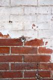 Red brick wall half painted in white vertical image Stock Image