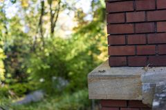 Red brick wall house corner with garden view. Architecture Stock Images