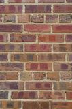 Red brick wall with interesting patterned stains stock photos
