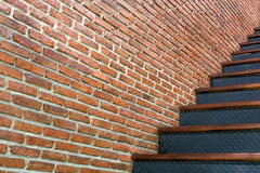 Red brick wall with iron stair background Royalty Free Stock Images