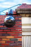 Red Brick Wall with Lamp Stock Photography