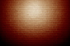 Red brick wall with light effect and shadow, abstract background Stock Photos