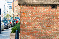 Red brick wall and London street Stock Image