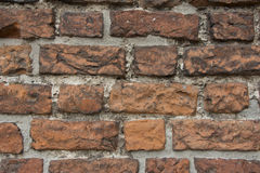 Red brick wall. Red brick medieval wall - details Stock Image