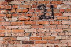 Red brick wall with number 21 Stock Photo
